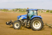Tractor on field, Czech Republic — Stockfoto