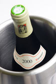 Bottle of Burgundy wine in winecooler — Stock Photo