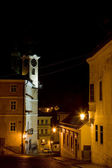 Square of St. Trinity with town hall at night, Banska Stiavnica, — Stock Photo