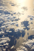 Clouds above ocean - view from plane — Stock Photo