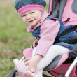 Toddler sitting in pram — Stock Photo #11290097