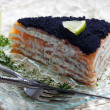 Cake of smoked salmon with caviar - Stock Photo