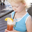 Portrait of little girl with a glass of cocktail — Stock Photo #11290966