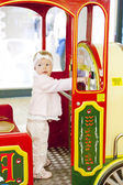 Standing toddler on carousel — Stock Photo