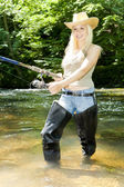 Woman fishing in river — Stock Photo