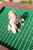 Little girl trampoline — 图库照片