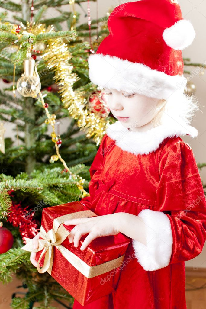 Little girl as Santa Claus with Christmas present  Stock Photo #11291136