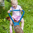 Little girl sitting on swing — Stock Photo