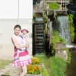 Mother with her daughte at water mill in Ratiborice, Czech Repub — Stock Photo #11424869