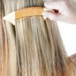 Detail of woman combing long hair — Stock Photo #11424929