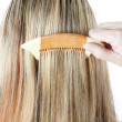 Detail of woman combing long hair — Stock Photo #11424930