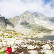 Woman backpacker at Five Spis Tarns, Vysoke Tatry (High Tatras), - Stock Photo