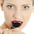 Portrait of woman with black caviar — Stock Photo #11425760