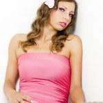 Portrait of sitting woman wearing pink dress — Zdjęcie stockowe #11425790