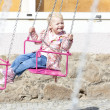 Little girl on carousel - Stock Photo