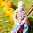 Little girl with pumpkins — Stock Photo