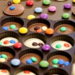 Still life of chocolate with smarties — Stok fotoğraf