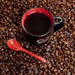Cup of coffee with coffee beans — Stock Photo #11427358