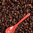 Teaspoon with coffee beans — Stock Photo