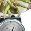 Green asparagus on kitchen scales — Stock Photo