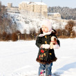 Standing little girl and Cesky Sternberk Castle in winter at bac — Stock Photo