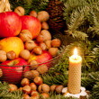 Christmas still life with a candle — Stock Photo #11428306