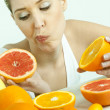 Portrait of young woman with citrus fruit — Stock Photo