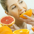 Portrait of young woman with citrus fruit — Stock Photo #11428841