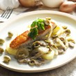 Baked salmon on champignons, onion and olives — Stock Photo