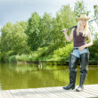 Fishing woman standing on pier — Stock Photo