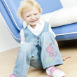 Little girl sitting on the floor — Stock Photo