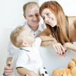 Portrait of parents with their little son — Stock Photo