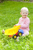 Little girl playing with little car — Stock Photo