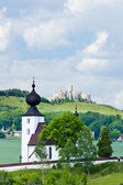 Church in Zehra and Spissky Castle at background, Slovakia — Stock Photo