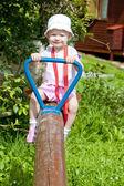 Little girl sitting on swing — Stock Photo