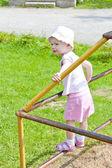 Little girl on climbing frame — Stock Photo