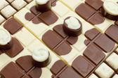 Chocolate bars with chocolate candies — Stock Photo