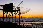 Pier with fishing net during sunrise, Gironde Department, Aquita — Stock Photo