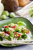 Asian vegetables on coconut milk — Stock Photo