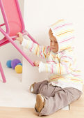 Toddler with a chair — Stock Photo