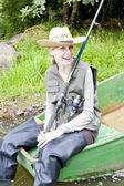 Fishing woman sitting on boat — Stock Photo