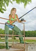 Woman fishing at pond — Stock Photo