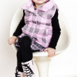 Little girl sitting on chair — Stock Photo