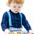 Little boy playing with puzzle — Stock Photo