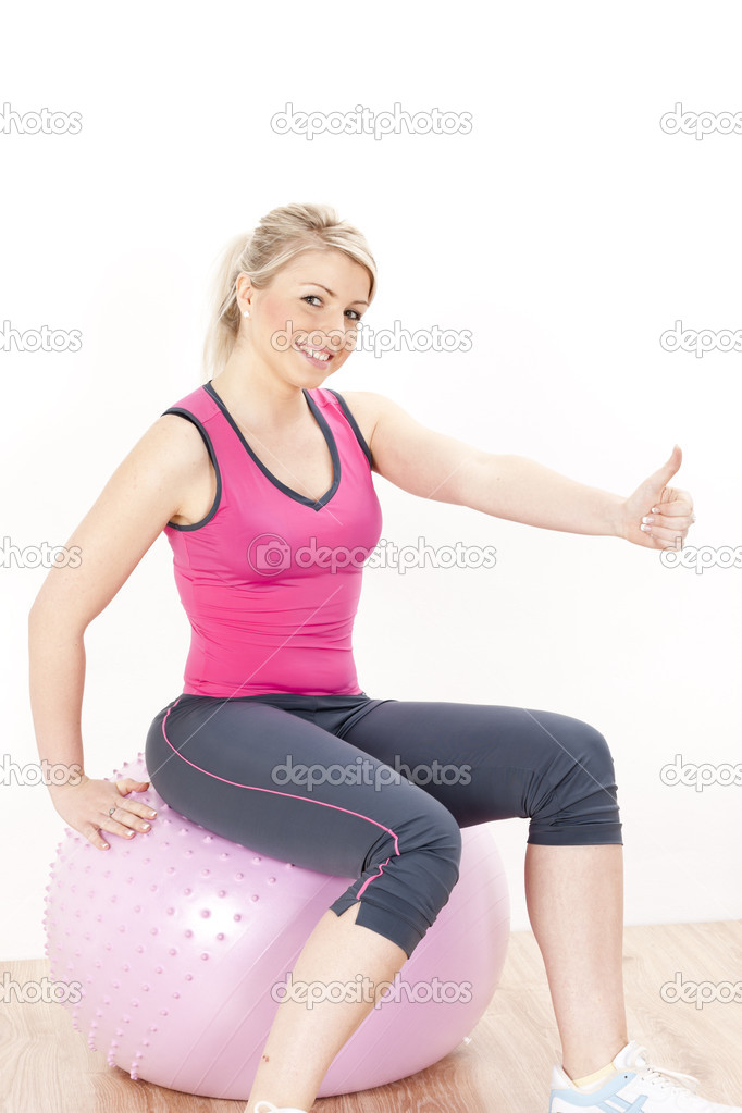 Young woman at gym  Stock Photo #11430336