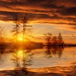 Sunset on lake - Stock Photo