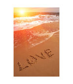 Love word on sea beach — Stock Photo