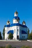 Cupola of church on blue sky bachground — Stock Photo