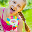Girl with lollipop — Stock Photo #11168959
