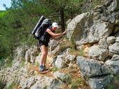 Hiker walking on a rocky path — Stock Photo